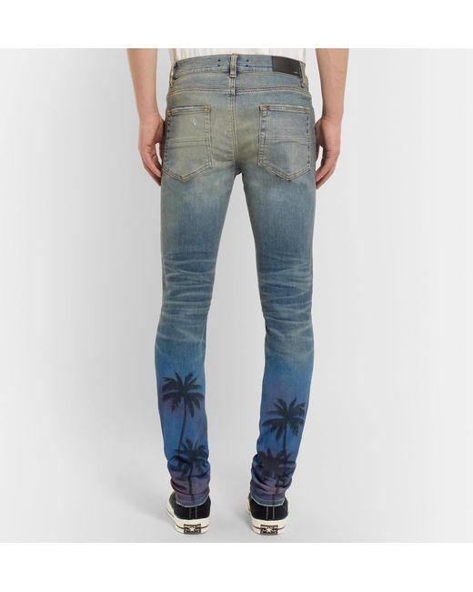 61f869ce36f354 amiri-blue-Thrasher-Skinny-fit-Distressed-Printed-Stretch-denim-Jeans.jpeg