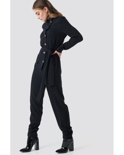 dfe2fc2b2467 NA-KD - Tie Waist Button Up Jumpsuit Black - Lyst ...