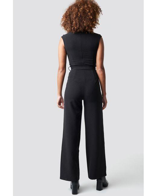 f719ff1ddcac ... NA-KD - Belted Waist Jumpsuit Black - Lyst ...
