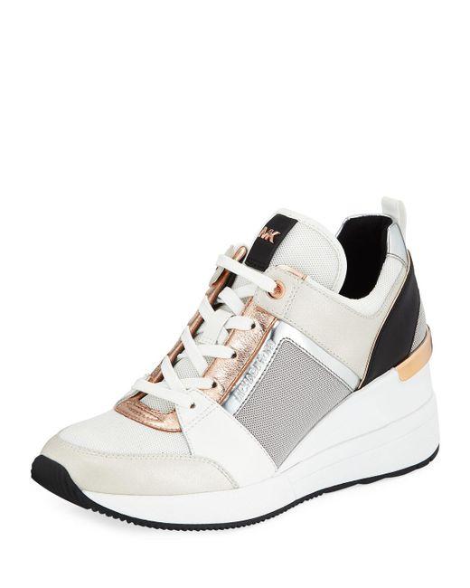 3b7b191bbca Lyst - MICHAEL Michael Kors Georgie Metallic Leather Wedge Sneakers ...