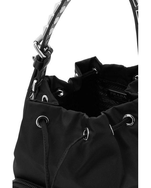 713d9ae59d70 ... Prada - Black Vela Stud-embellished Leather-trimmed Shell Tote - Lyst