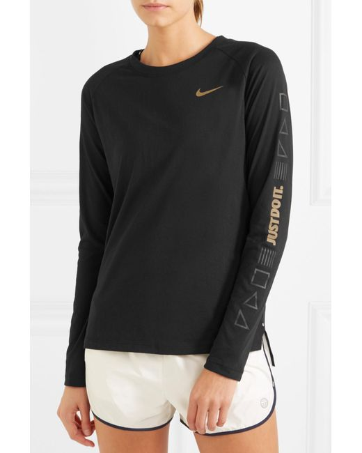 7a7a5708 Nike Tailwind Printed Perforated Stretch-jersey Top in Black ...