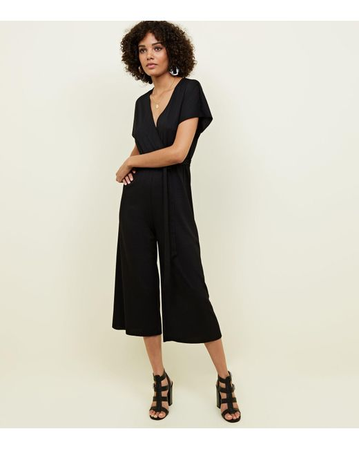 22e16e0321b5 New Look - Black Wrap Front Ribbed Jersey Jumpsuit - Lyst