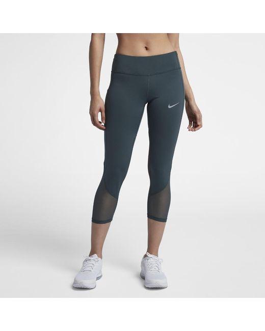 a60b2e43d122d Lyst - Nike Power Women's Running Crops in Blue