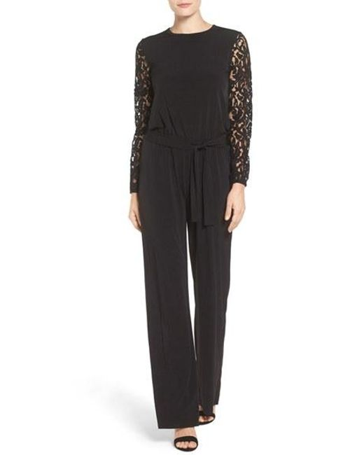 michael michael kors lace sleeve jersey jumpsuit in black lyst. Black Bedroom Furniture Sets. Home Design Ideas