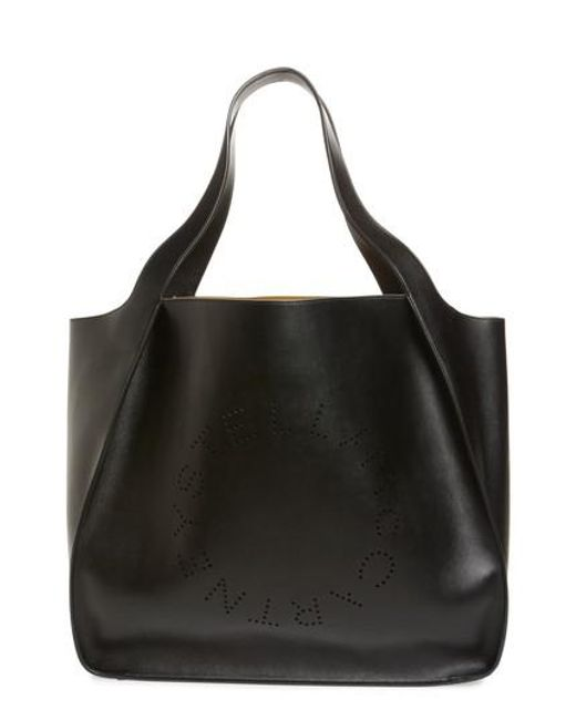 Stella Mccartney Black Extra Large Perforated Logo Faux Leather Tote Lyst