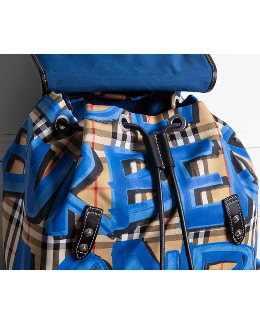 ... Burberry - Blue Graffiti Logo Print Vintage Check Backpack for Men -  Lyst ... fa2825dfa7