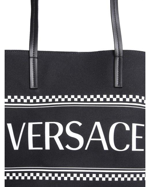 f6d729cbdae ... Versace - Black Maxi Logo Printed Coated Canvas Tote Bag - Lyst ...