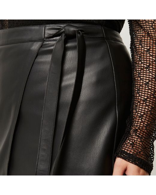 river island plus black leather look wrap skirt in black