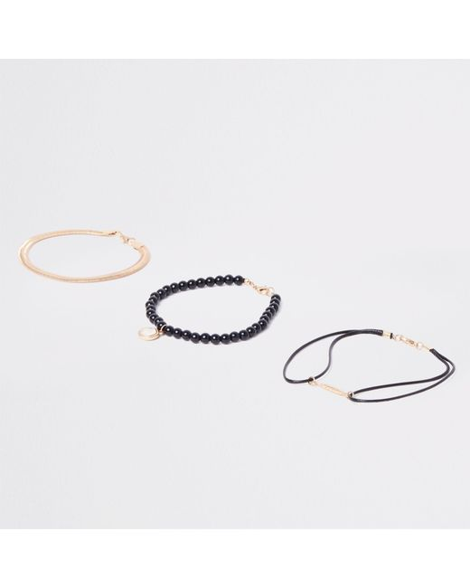 River Island - Metallic Gold Tone Feather And Bead Bracelet Pack for Men - Lyst