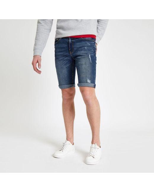 a0173ff926 River Island - Mid Blue Sid Skinny Stretch Ripped Shorts for Men - Lyst ...