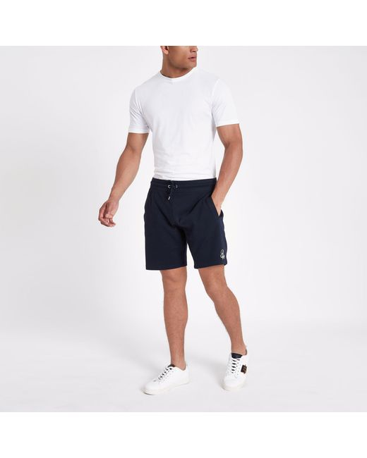 7f429194de River Island - Blue R96 Embroidered Slim Fit Jersey Shorts for Men - Lyst  ...