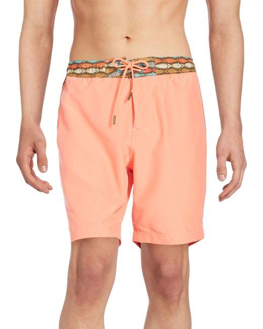 Rainforest fish print swim shorts in orange for men lyst for Fishing swim trunks