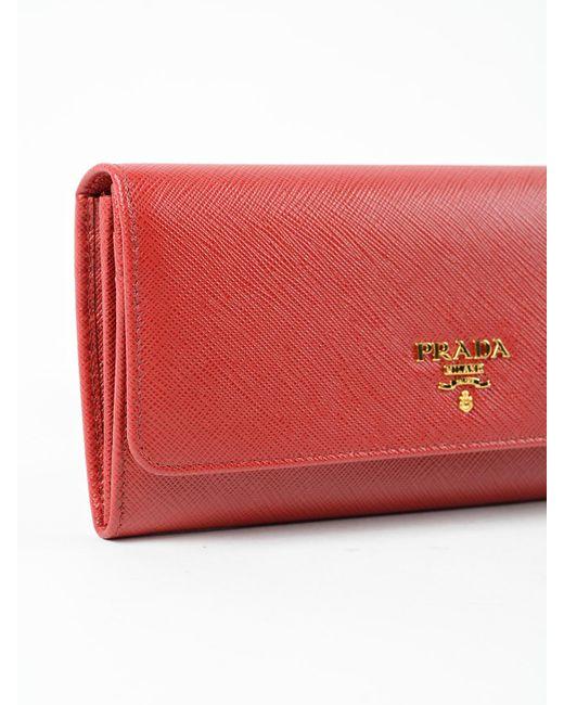 8c35cbf96c8c ... store prada red saffiano continental flap wallet lyst 7ab80 86ea0