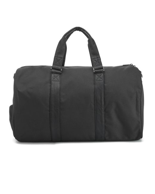 fa2662712876 ... Herschel Supply Co. - Black Novel Duffle Weekend Bag for Men - Lyst ...