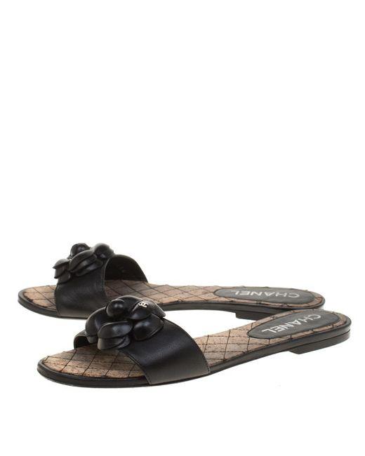 3daef7e3305c ... Chanel - Black Leather Camellia Embellished Cc Flat Slides Size 38 -  Lyst ...