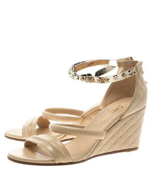 cbb1fec687ba ... Chanel - Natural Beige Quilted Leather Charm Embellished Ankle Cuff  Wedge Sandals Size 40.5 - Lyst ...