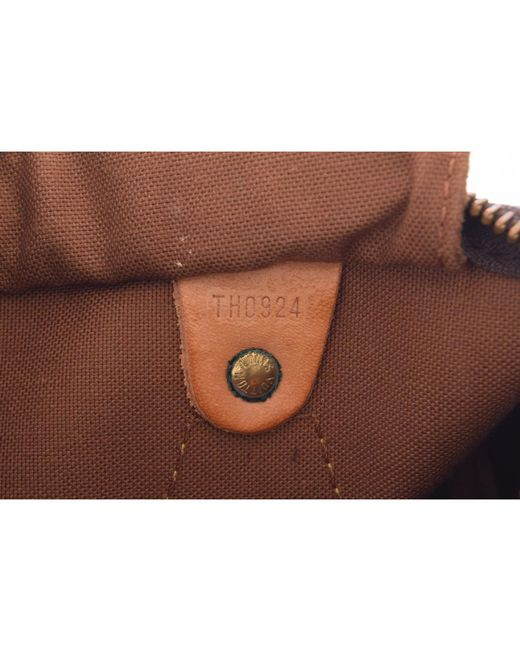 ac32da0c821f ... Louis Vuitton - Brown Monogram Canvas Speedy 25 Bag - Lyst ...