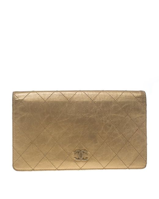 4f807ba7b7abda ... metallic gold lambskin; chanel gold quilted leather clic bifold  continental wallet in ...