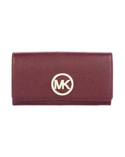 f98e32aae14bb MICHAEL Michael Kors - Metallic Michael Kors Leather Flap Wallet Gold -  Lyst ...