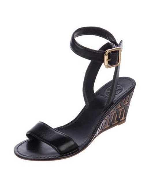 94ab51bce3d2 ... Tory Burch - Black Leather Wedge Sandals - Lyst ...