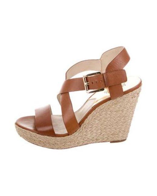 baa8a0678c9 MICHAEL Michael Kors - Brown Michael Kors Leather Wedge Sandals - Lyst ...