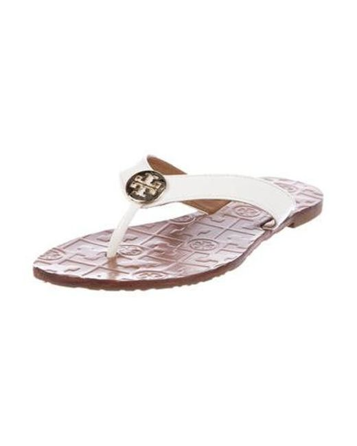 9e604d670af ... Tory Burch - Metallic Patent Leather Thong Sandals White - Lyst ...