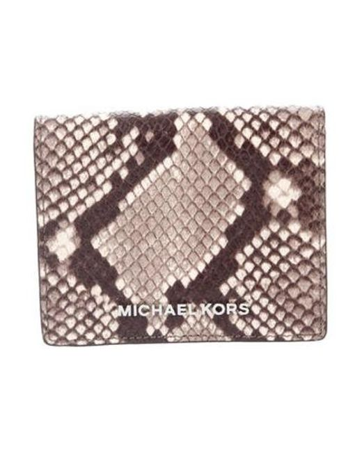 148be54500c9 Michael Kors - Metallic Embossed Leather Compact Wallet Brown - Lyst ...