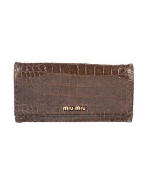 96c40c7a05ed Miu Miu - Metallic Miu Embossed Continental Wallet Brown - Lyst ...