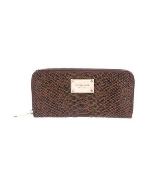 1d18cffb83e8 Michael Kors - Metallic Embossed Leather Zip Wallet Brown - Lyst ...