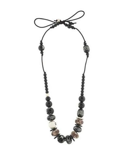 Chanel - Black Embossed Bead Necklace - Lyst