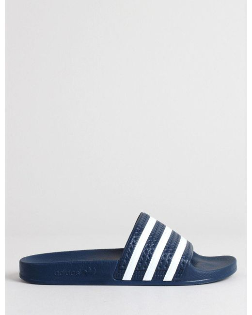a4e0219c0ebf adidas Originals Adilette Slides in Blue for Men - Save 33% - Lyst