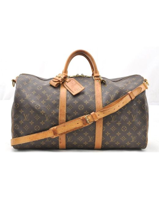 8eb9e463991c Louis Vuitton Vintage Keepall Brown Cloth Travel Bag in Brown - Save ...