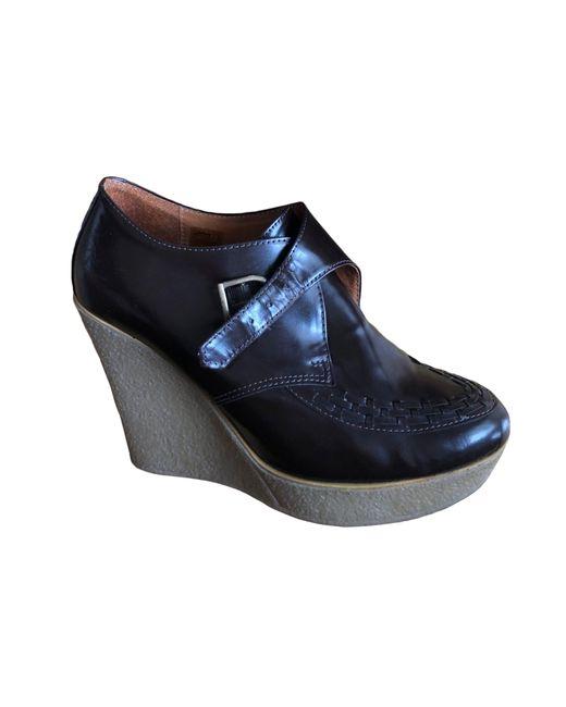 Bottines & low boots à compensés cuir marron Sandro en coloris Brown