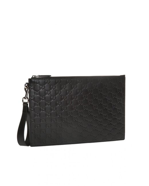 1c347714e ... Gucci - Black GG-embossed Clutch for Men - Lyst ...