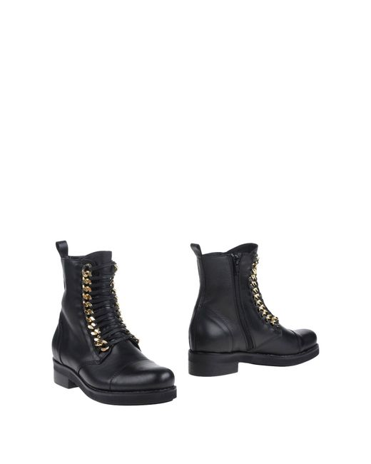 versace ankle boots in black save 31 lyst