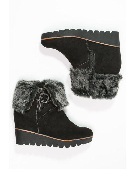 tamaris wedge boots in black lyst