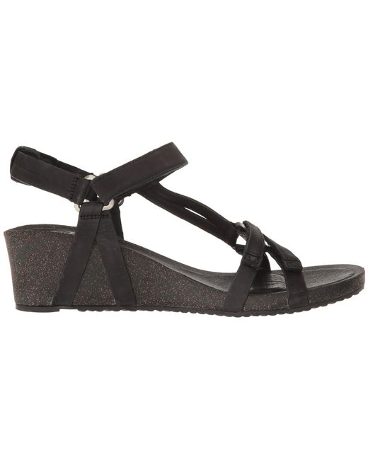 b3e8d7391d19 Lyst - Teva Ysidro Stitch Wedge Sandals in Black - Save 14%