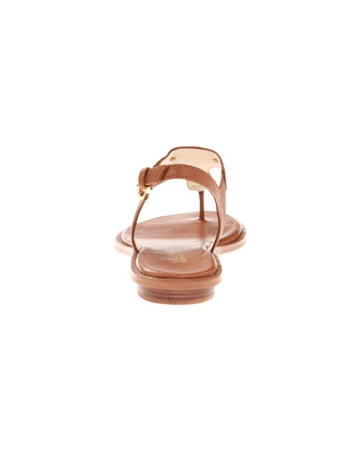 7f839356195 ... MICHAEL Michael Kors - Brown Mk Plate Thong (Luggage) Women s Sandals  ...