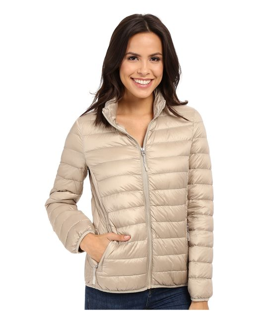 Tumi Clairmont Packable Travel Puffer Jacket In Beige Sand Lyst