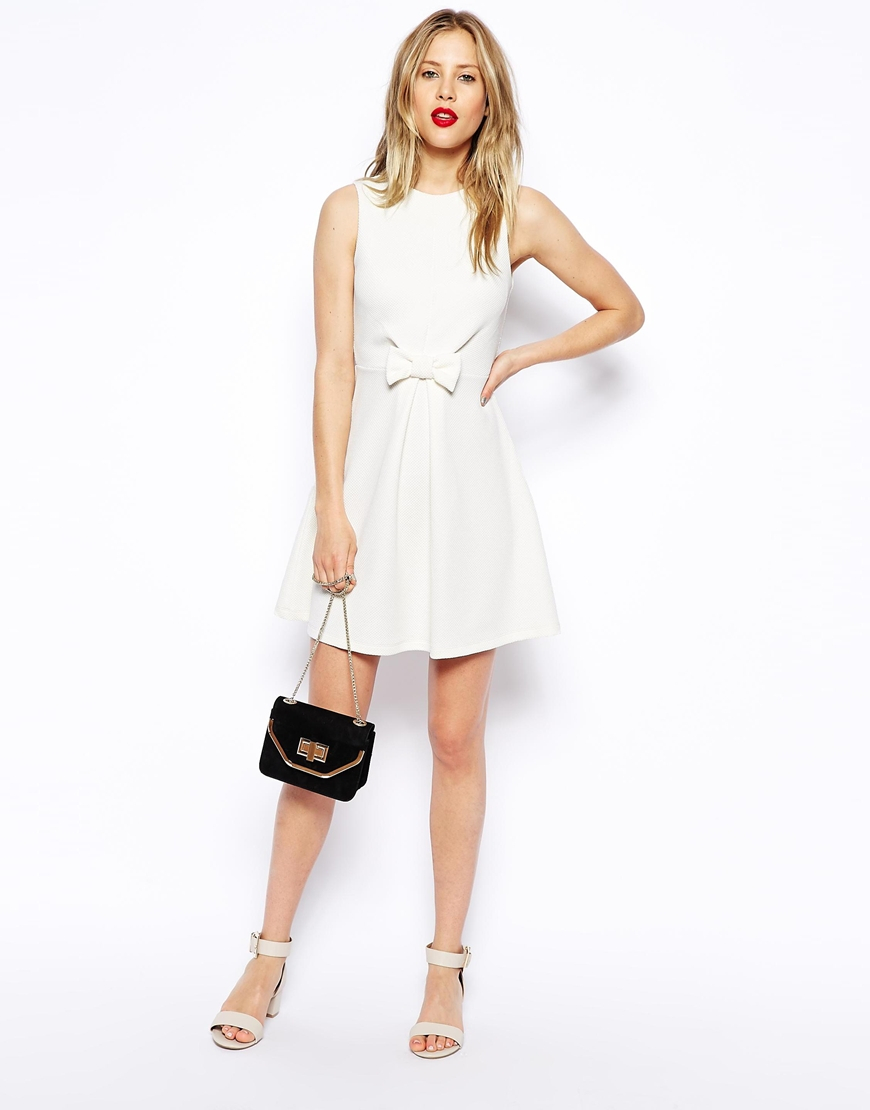 White bow front dress.