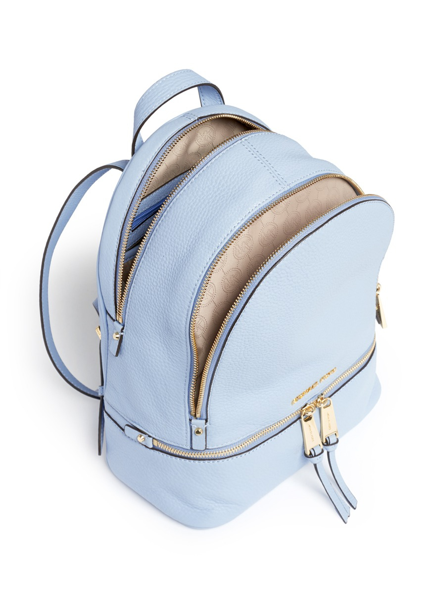 7d1ea5c3d522f0 ... shop michael kors rhea small 18k gold plated leather backpack in blue  5e286 91327