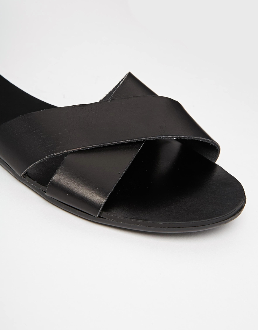 7f068e960321 Lyst - Pieces Black Leather Sara Flat Sandals in Black