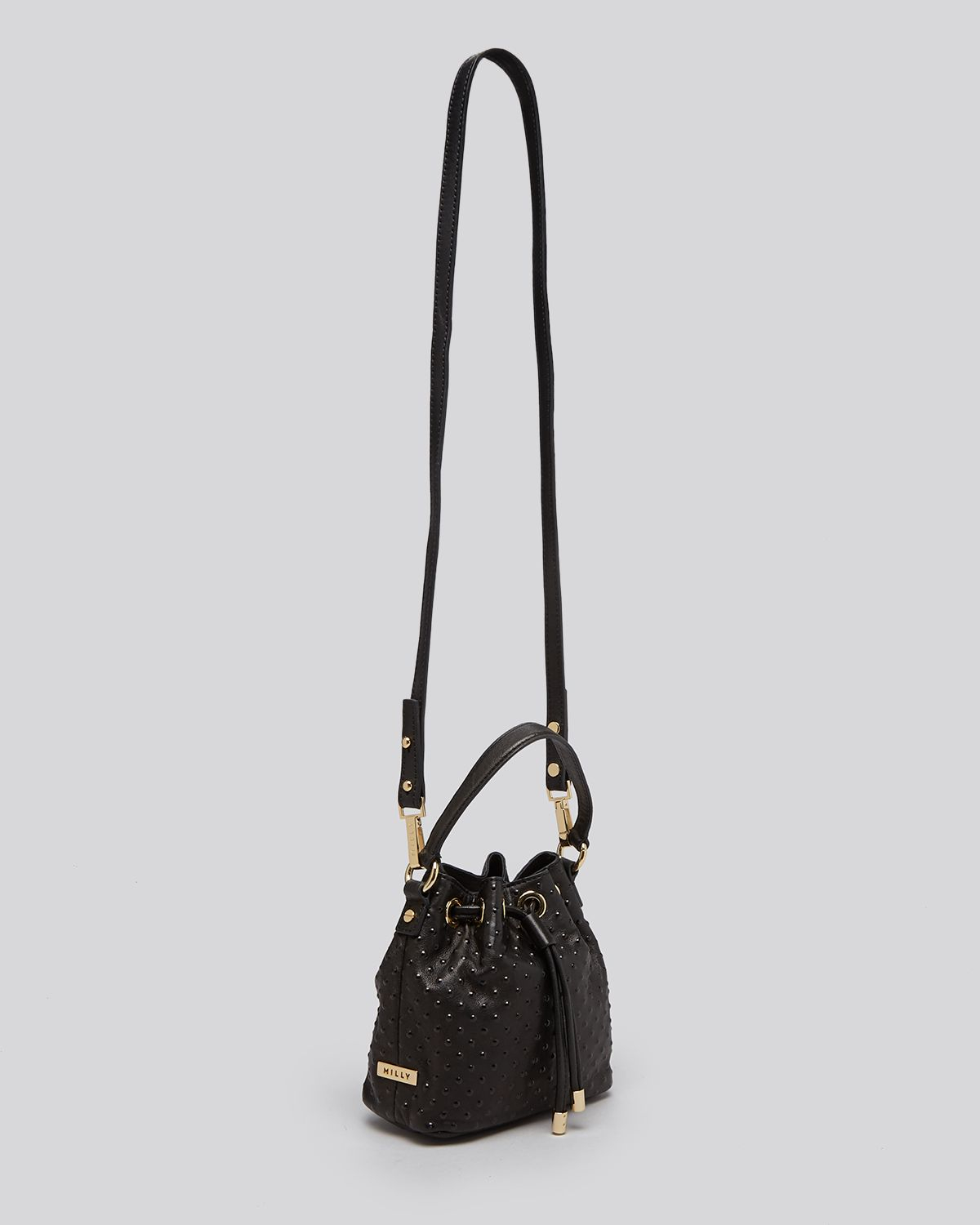 ebb6f4944525 Lyst - MILLY Crossbody - Perry Dot Mini Drawstring Studded Bucket in ...