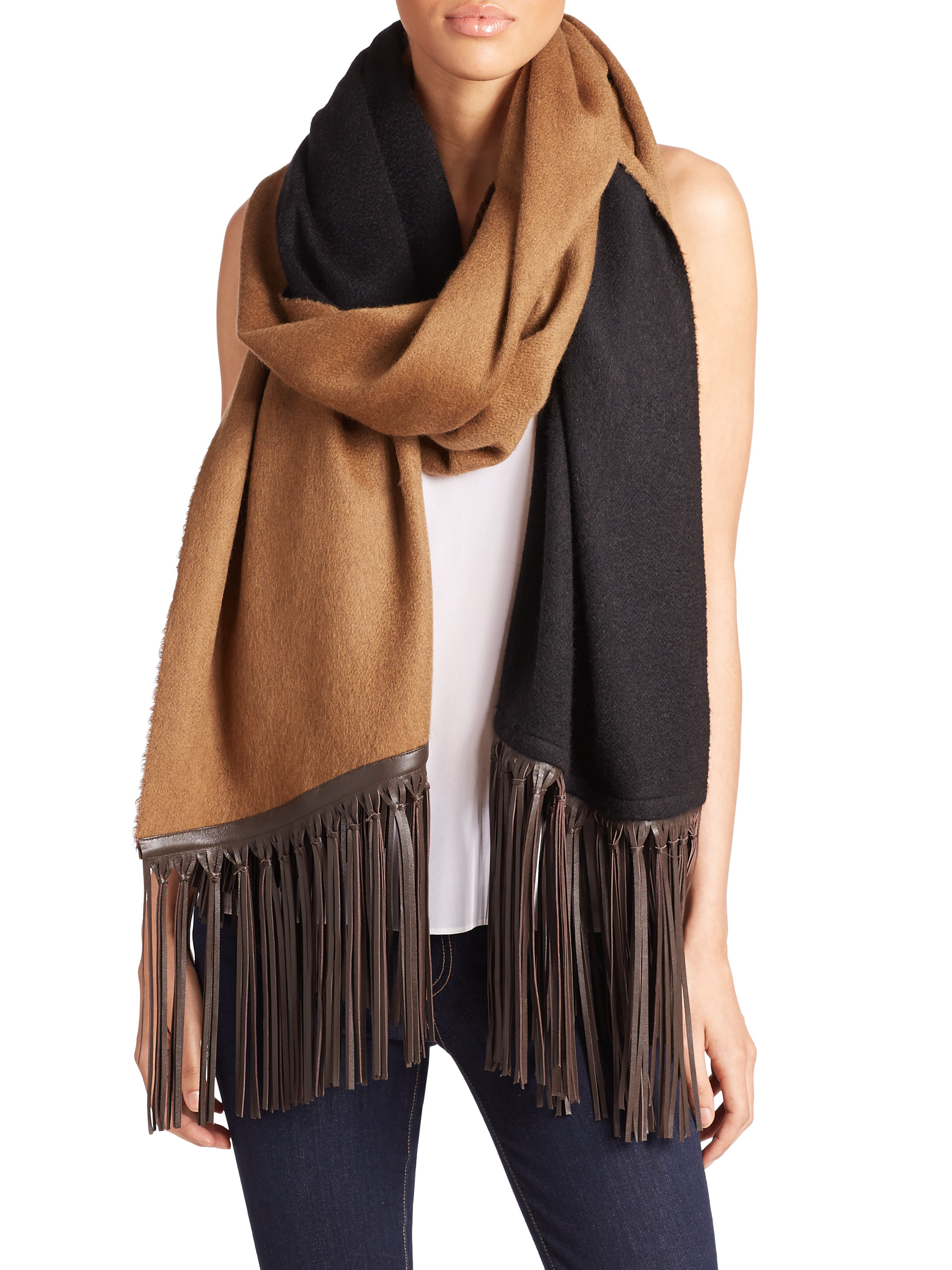 Barneys New York's black and white striped double-faced cashmere twill scarf is woven at the end with grey stripes. Designed with self-fringed ends, this ultra-soft style is crafted in an Italian mill that specializes in age-old weaving techniques.