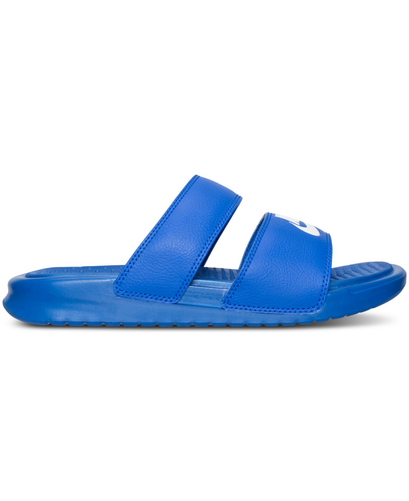 separation shoes 50ad0 bd6e3 ... hot lyst nike womens benassi duo ultra slide sandals from finish line  23e9a b1dbc
