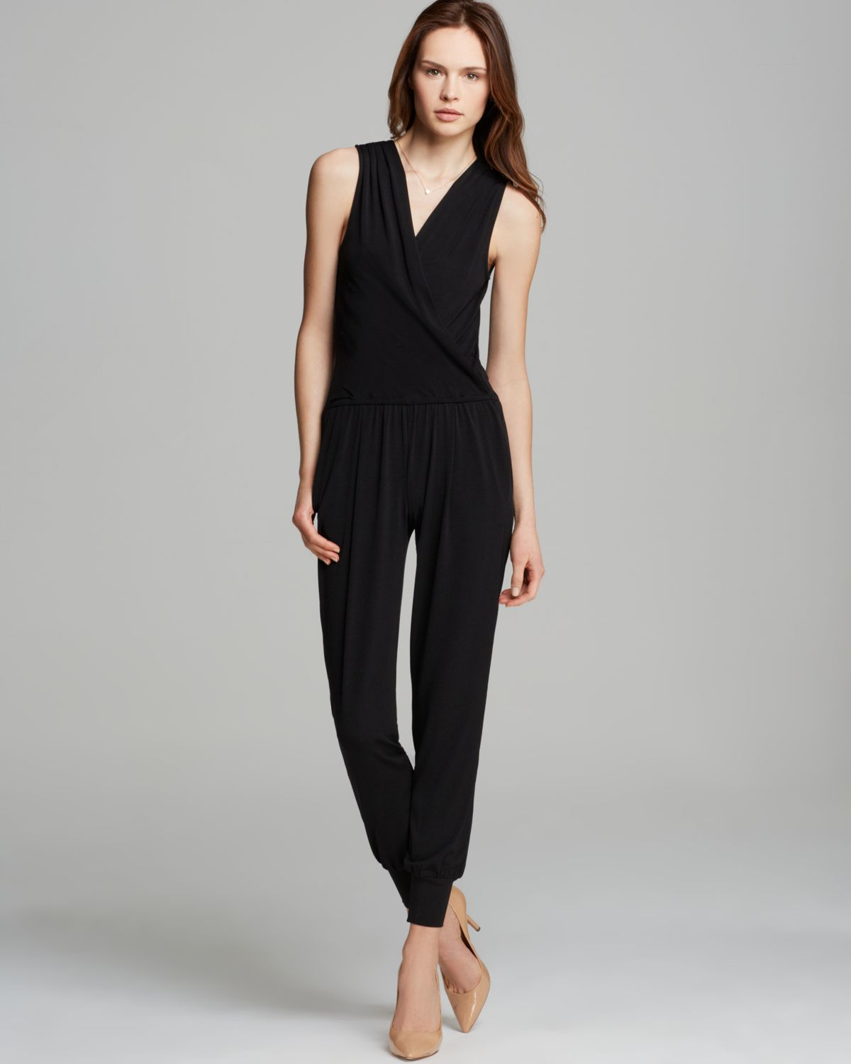 A chic sleeveless utilitarian inspired jumpsuit. All-occasion ready with a flattering V shaped neckline and straight leg pants.