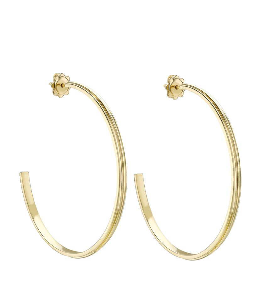 theo fennell gold whip large hoop earrings in metallic lyst