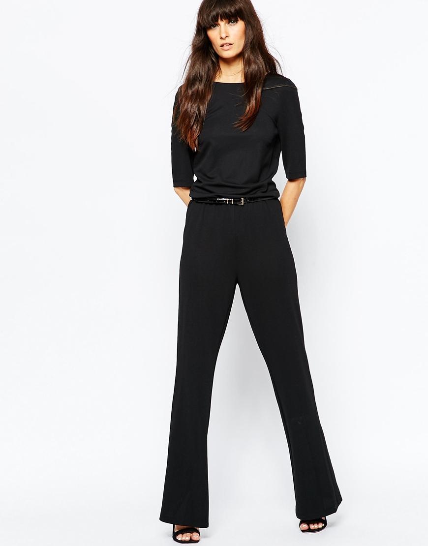 vero moda flared jumpsuit in black lyst. Black Bedroom Furniture Sets. Home Design Ideas