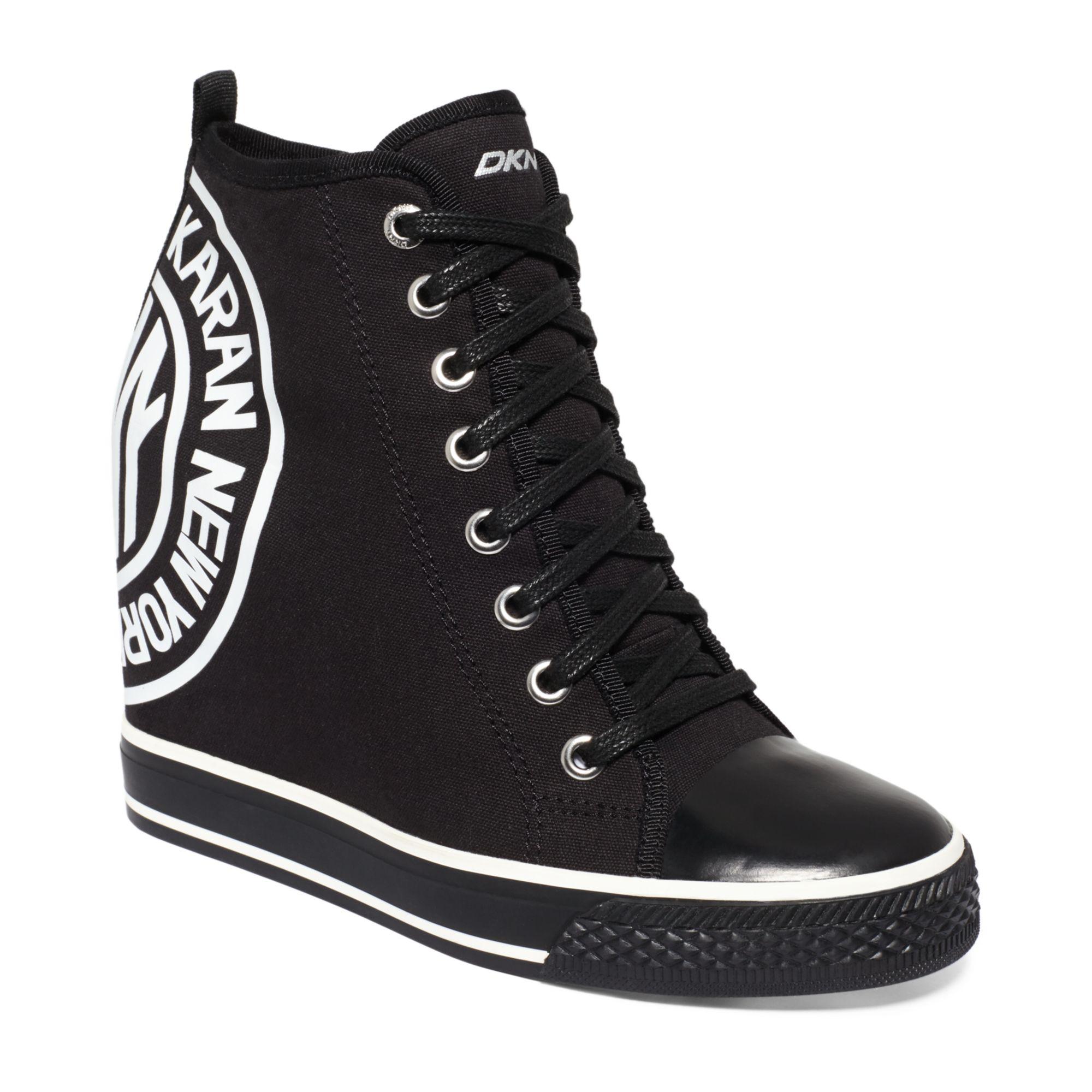 6141d22f2f56 Dkny black grommet wedge sneakers product normal jpg 2000x2000 Dkny wedge  active sneaker